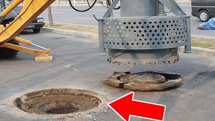 Niemieccy drogowcy w akcji. Klapa kanalizacji zlicowana z jezdnią